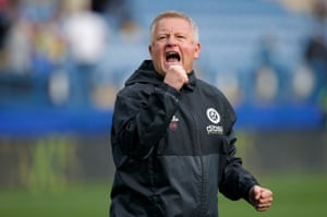 United manager Chris Wilder celebrates after their 4-2 win.