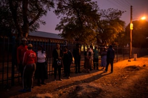People queue to vote at a polling station in the Seshego township, on the outskirts of Polokwane