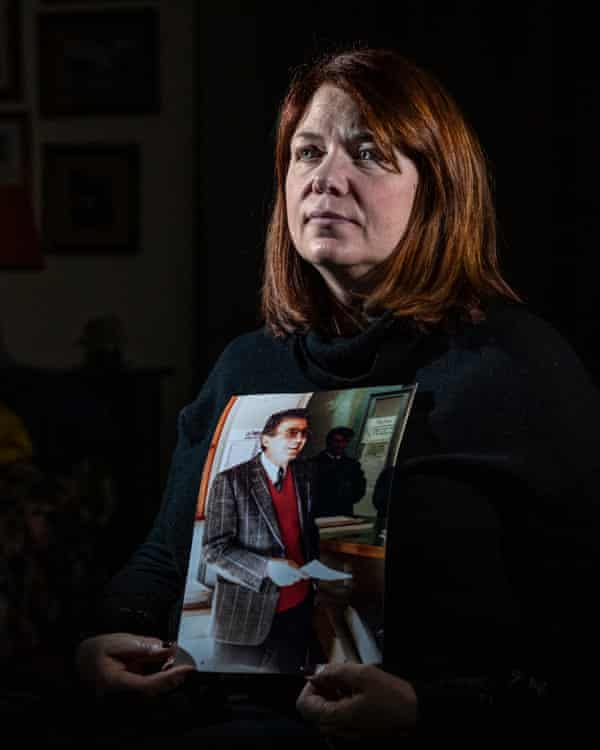 Daniela Marcone, with a photo of her father, Francesco Marcone, murdered by the mafia in 1995 in Foggia.
