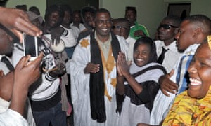 Mauritanian anti-slavery activist Biram Ould Abeid (centre) is welcomed by supporters as he walks out of jail after the supreme court downgraded his crimes.