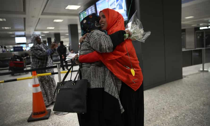 A woman hugs her daughter arriving from Somalia at Dulles international airport on 6 February.