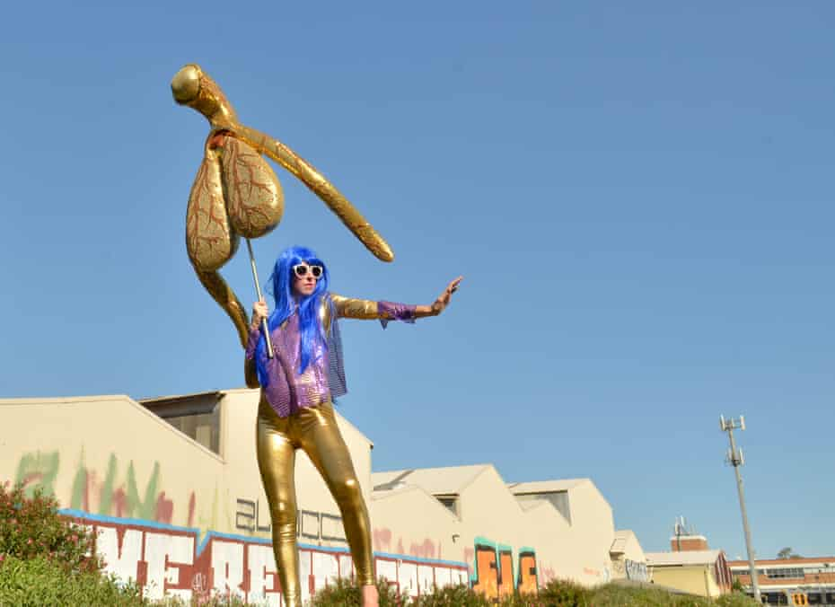 Sydney artist Alli Sebastian Wolf holds up her Glitoris, a giant, gold clitoris devised by the to highlight lack of understanding in the female anatomy.