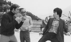 Raymond Chow with actors Bruce Lee and John Saxon on the set of Enter the Dragon in 1973.