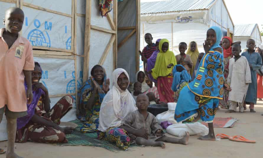 Displaced families outside shelters in Maiduguri.