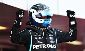 Race winner Valtteri Bottas celebrates in parc ferme.