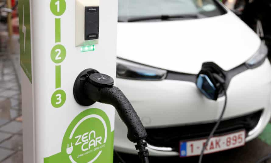 an electric car is charged up
