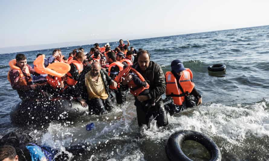 Syrian refugees arrive on the shores of Lesbos island in Greece in an inflatable boat from Turkey.