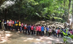 A queue of tourists waiting to visit the cave.