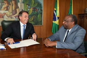 26 June: Bolsonaro and the minister of education, Carlos Alberto Decotelli, the first black minister in his cabinet, at Planalto Palace in Brasília.