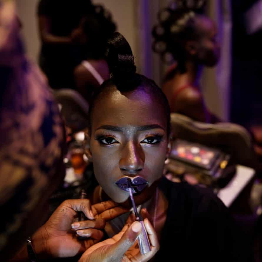 A models gets her makeup done backstage during Dakar fashion week, June 2017