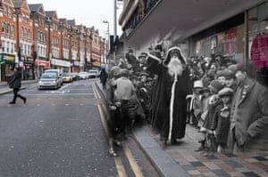 Father Christmas arrives at the Arding and Hobbs store on 2 November 1926 in Clapham Junction. Shoppers walk past on 24 November 2017