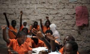 Schoolgirls participate in a lesson in Kilifi, north-east of Mombasa, Kenya.