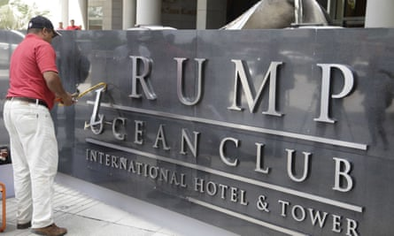 A man removes the word Trump, off a marquee outside the Trump Ocean Club International Hotel and Tower in Panama City on Monday.