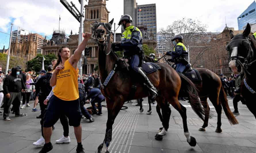 A protester clashes with mounted police in Sydney on Saturday.