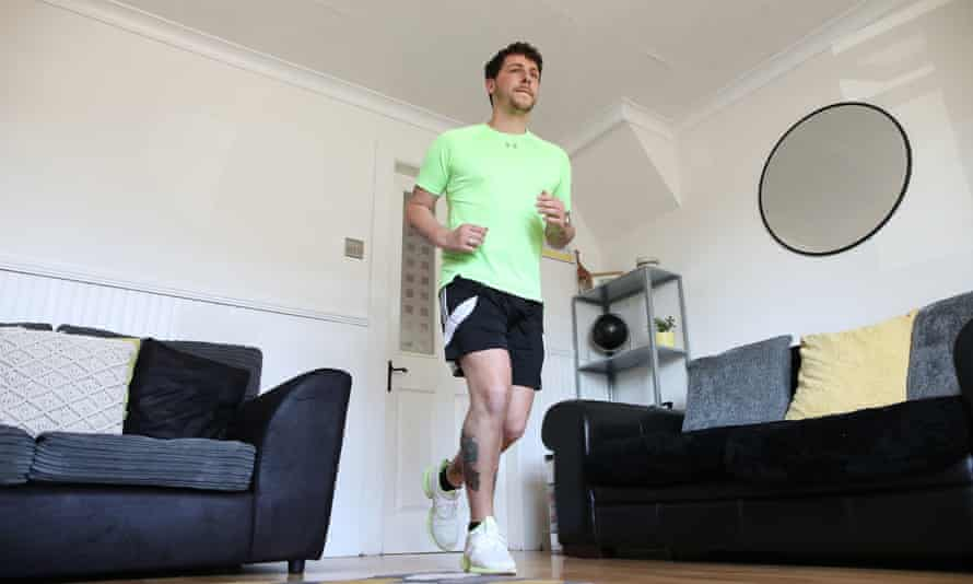 Col Bignell trains in preparation for his marathon in his front room.
