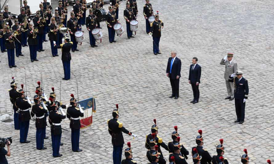 Donald Trump, Emmanuel Macron and the military governor of Paris and French army general Bruno Le Ray stand during a welcome ceremony at Les Invalides in Paris.