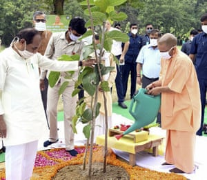 Chief Minister, Yogi Adityanath (right) inaugurates a day long tree planting campaign across the state in Lucknow, India