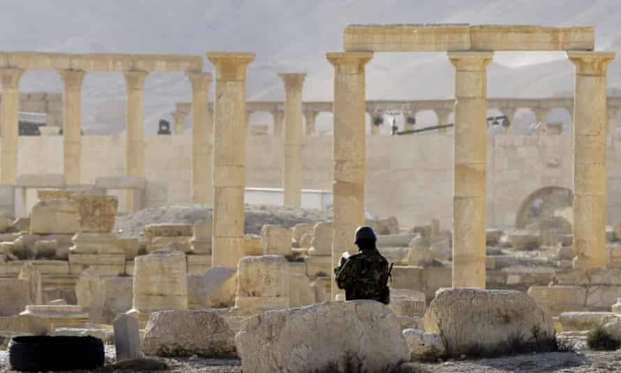 A member of the Syrian army patrols the ancient Syrian city of Palmyra.