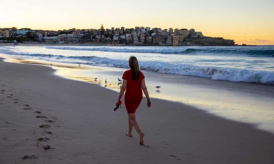 A woman walks along Sydney's Bondi beach