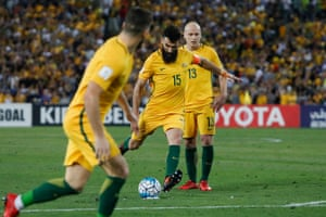 Jedinak smashes the free-kick goalwards and a deflection wrong-foots the keeper, sending the ball into the net. 1-0 to Australia.