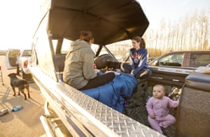 Canadian wildfires: a family takes refuge in the back of their boat after leaving their home in Fort McMurray