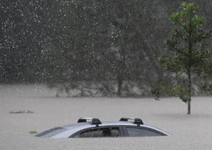 A car sits in flood waters