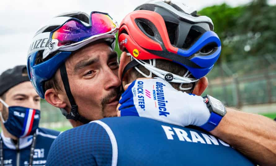 The new men's world road race champion, Julian Alaphilippe, celebrates with a French teammate after sealing victory in Imola.