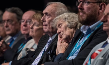A woman sleeps through Philip Hammond's speech Conservative party conference in Manchester last year.