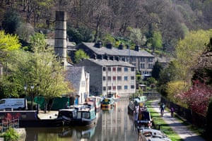April 2020: a man and his child cycle alongside the canal in Hebden Bridge