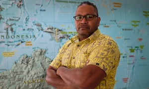 Tevita Tupou, from the Oceanic Customs Organisation, in front of a Pacific region map