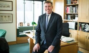 Graham Brady in office smiling