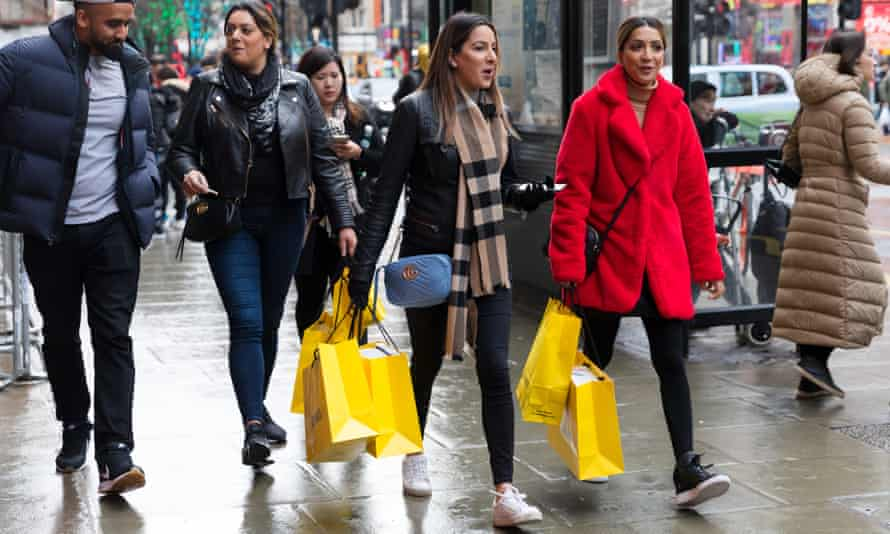 Boxing day shoppers in London. If you've spent too much over the festive period, it's time to take stock.