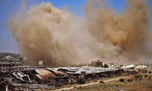 Smoke rises above opposition-held areas of Daraa province on Wednesday.