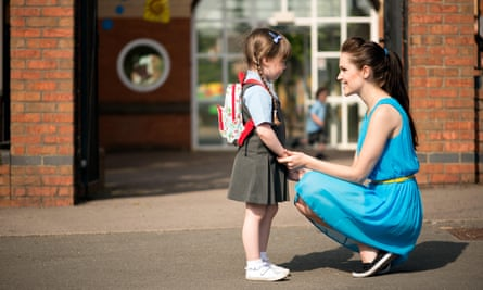 A woman with a small child in school uniform.