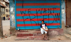 Graffiti reads 'We want freedom' on a shopfront in Srinagar.