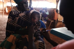 Abuk Majak Agany holds her 10-month-old son at a feeding center in north-western South Sudan