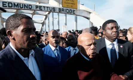 John Lewis crosses the Edmund Pettus Bridge in Selma in March, on the 55th anniversary of Bloody Sunday.