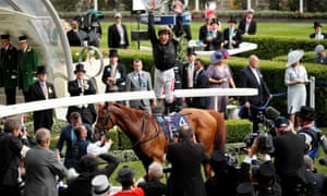 Frankie Dettori leaps off Stradivarius as he celebrates after winning the Gold Cup.