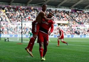 Watford's Richarlison celebrates his winner against Swansea City with Troy Deeney.