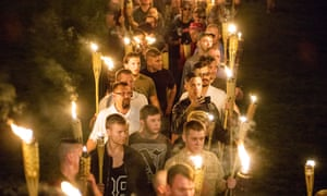 White nationalists and white supremacists carrying torches march through the University of Virginia campus last August.