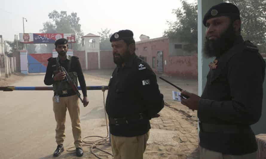 Police officers stand guard outside Multan jail