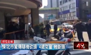 Screengrab from local TV showing the scene of the attack outside a metro station in Taipei.