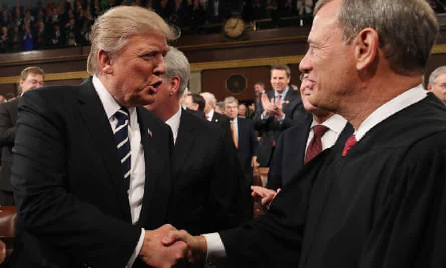 Donald Trump with supreme court chief justice John Roberts as Trump arrives to deliver his first address to a joint session of Congress in Washington DC on 28 February 2017.