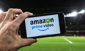 Amazon Prime image on mobile phone with football pitch in background