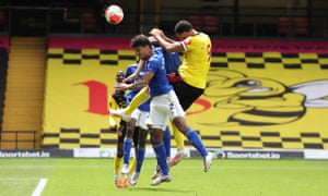 Troy Deeney of Watford outjumps James Justin of Leicester City but his header goes just wide of the Foxes' goal.
