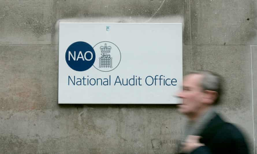 A pedestrian walks past Britain's National Audit Office in London