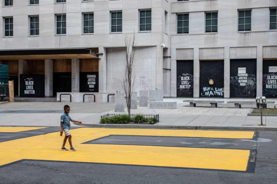 boy walks on Washington street