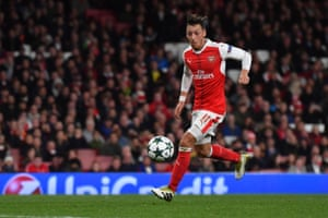 Ozil shoots to score his hat-trick, and Arsenal's sixth.