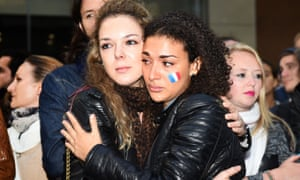 Two women embrace at a vigil held by the French community in Sydney, Australia.