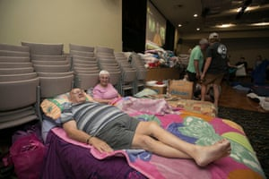 John and Lucy Van Hoof evacuated from their caravan to an auditorium of the Tuncurry Bowling Club.
